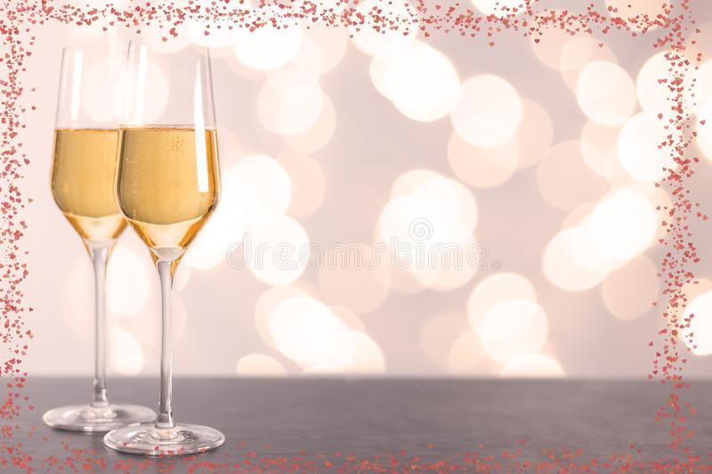 Champagne glasses with hearts and Blurred background royalty free stock photography