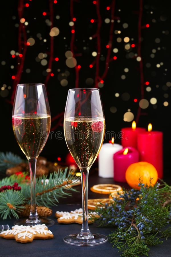 Champagne glasses in holiday setting. Christmas and New Year celebration with champagne. Christmas holiday decorated table. royalty free stock photography