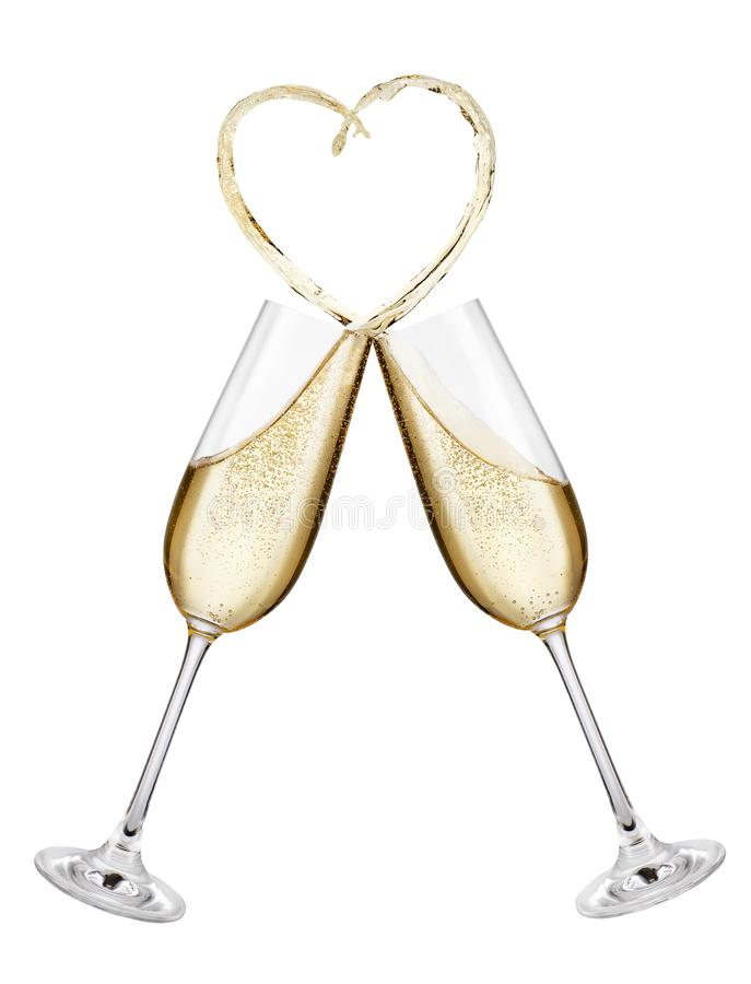 Champagne glasses making toast. Glasses of champagne making toast with splash in the shape of heart isolated on white background royalty free stock photography