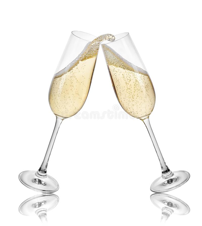 Champagne glasses making toast. Glasses of champagne making toast with splash isolated on white background stock images