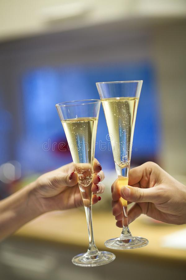 Champagne glasses in man and woman hands stock photos