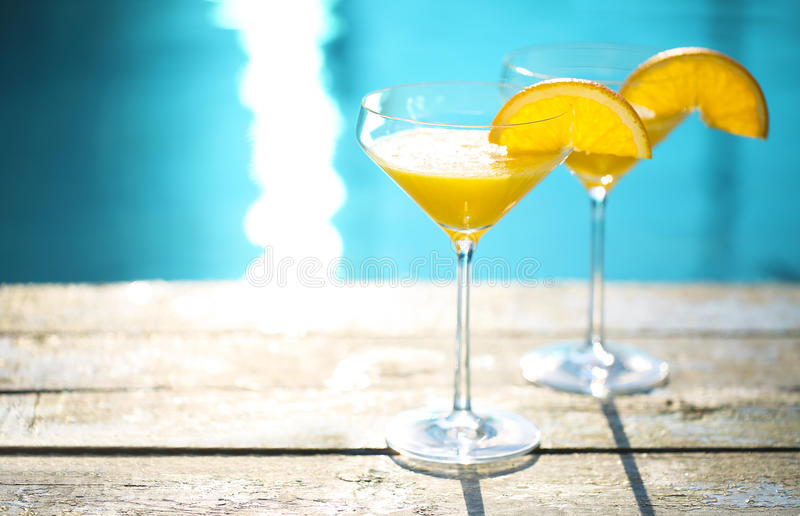 Champagne glasses with orange slice Mimosa cocktail. Champagne glasses with orange slice. Mimosa cocktail. Summer pool party royalty free stock photos