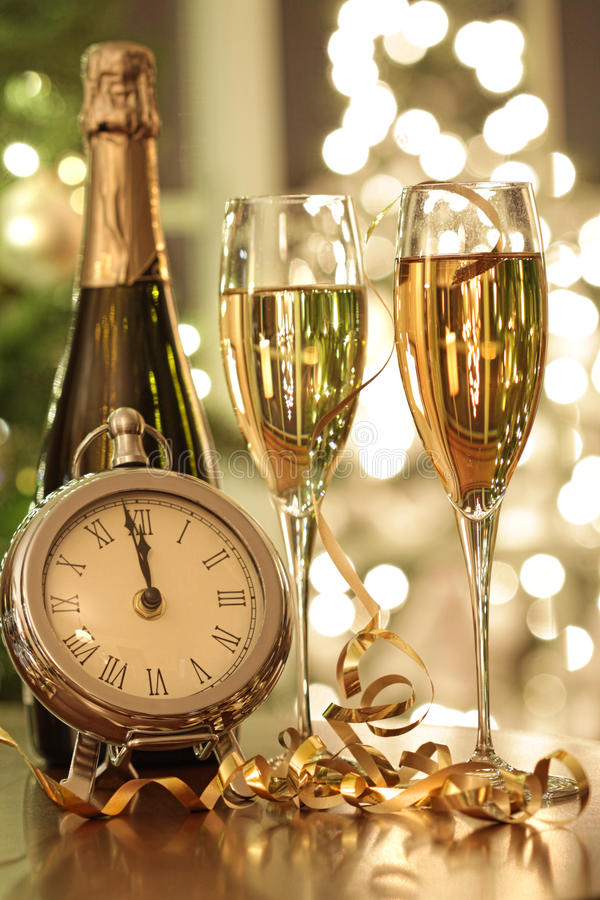 Champagne glasses ready to bring in the New Year. Eve royalty free stock photography