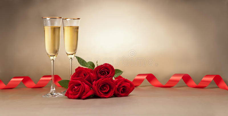 Champagne glasses and roses stock photo