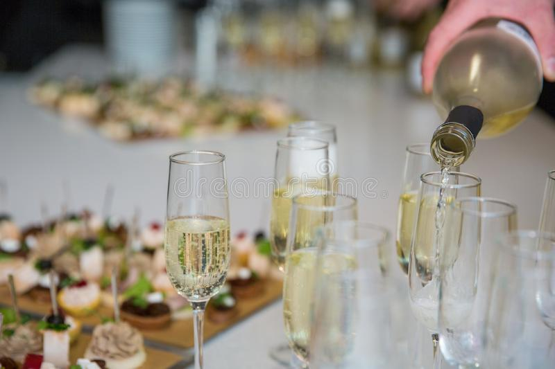 Champagne glasses on table. Celebration concept. Alcohol and cocktail party. royalty free stock image