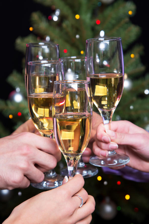 Champagne glasses during toast. Photo of champagne glasses during toast at party stock photos