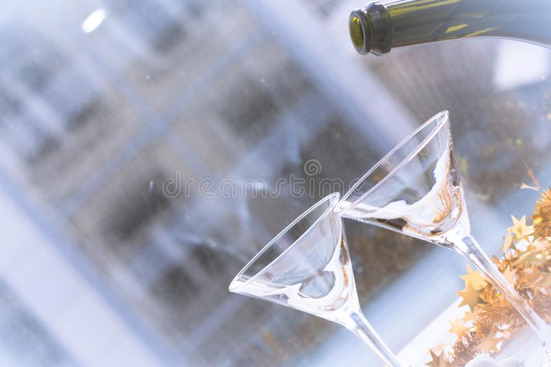 Champagne is going to be poured into a glass stock images