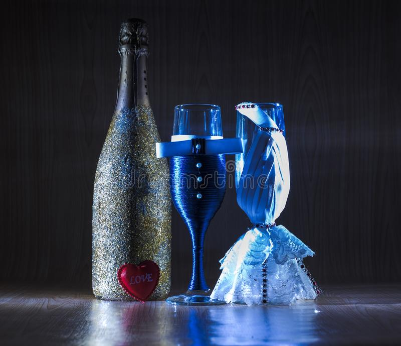 Dressed glasses and adorned Champagne stock photography