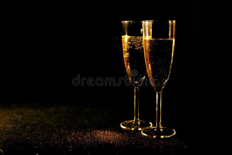 Champagne i exponeringsglaset arkivfoto