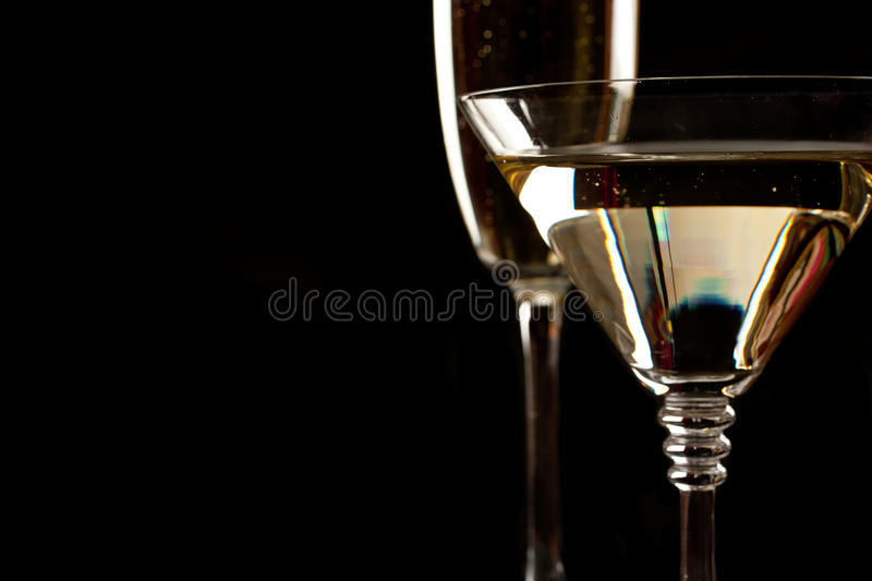 Champagne And Martini Glasses Over Black Stock Photos