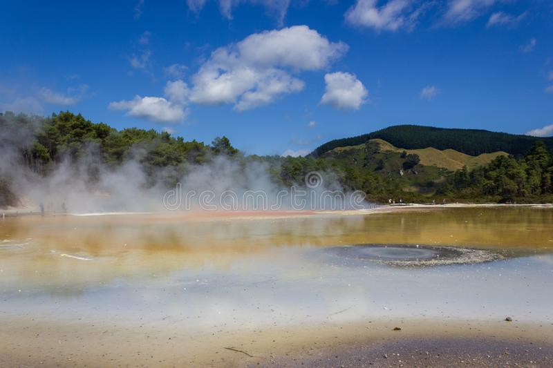 Champagne pool in Wai-O-Tapu thermal wonderland in Rotorua, New Zealand. Rotorua is known for geothermal activity, geysers and hot mud pool located around the stock photos