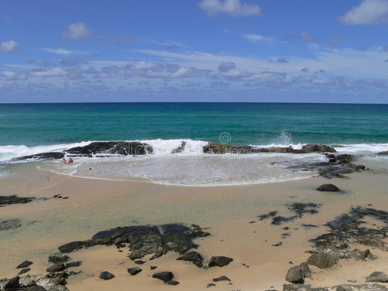 Champagne Pools, Fraser Island, Australia. The Champagne Pools at Fraser Island, Australia are a popular swimming hole on the island. The pools are naturally royalty free stock image