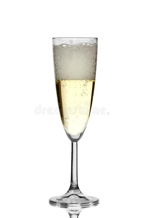 Champagne is poured from a bottle into a glass, isolated on a white background royalty free stock photos