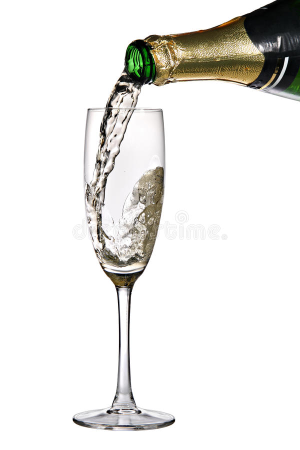 Champagne poured into flute. Champagne poured into glass or flute on a white background stock photo