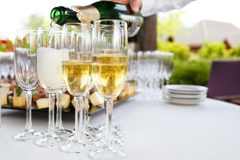 Champagne poured into glasses royalty free stock photos