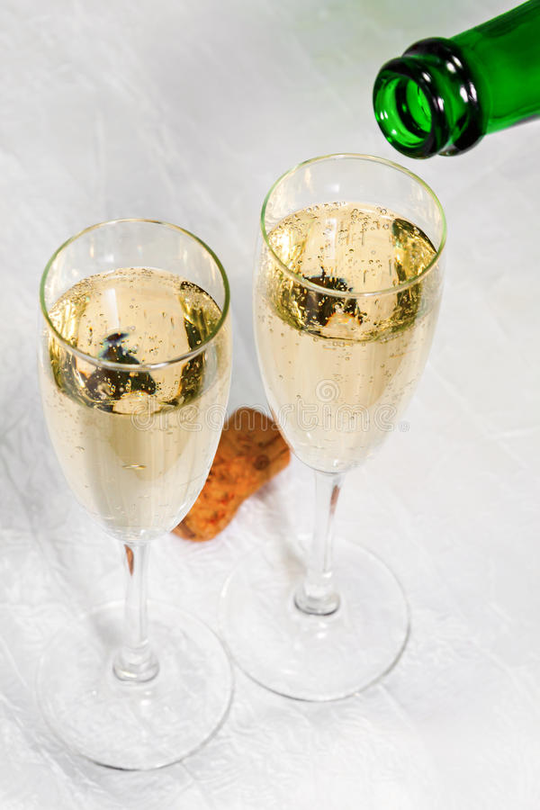 Champagne poured into two glasses close up stock photos