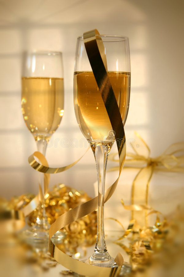 Champagne and ribbons/ Soft focus. Champagne glasses and ribbons ready for the New Year stock image