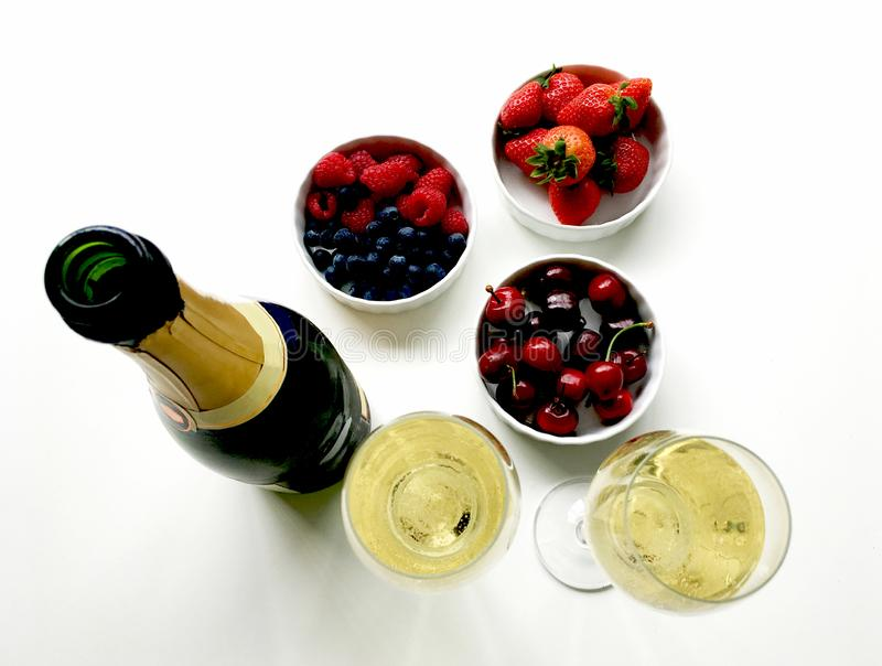 Celebrations with champagne and healthy snacks stock image