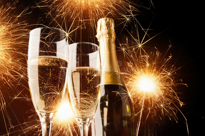 Champagne with sparklers stock photography