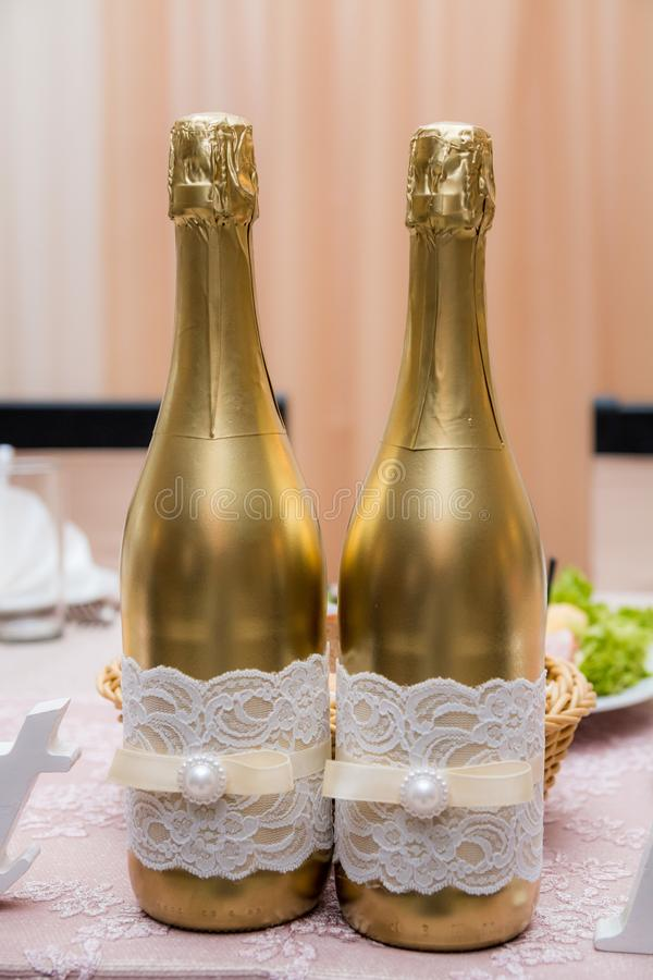 Champagne to the newlyweds on the table royalty free stock images