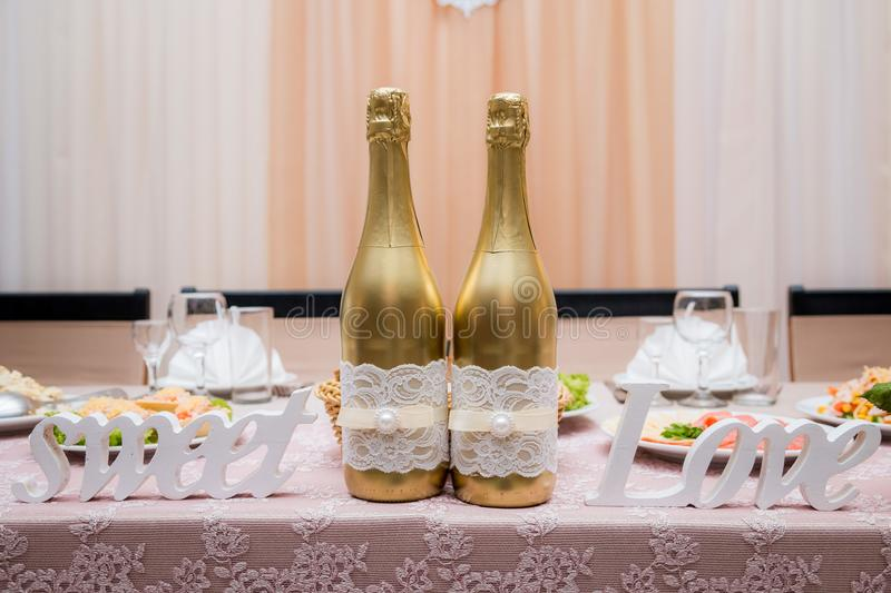 Champagne to the newlyweds on the table stock photo