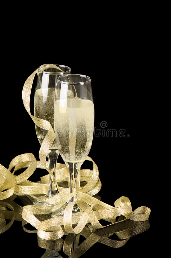 Champagne Toast. With two glasses and golden ribbons stock photo