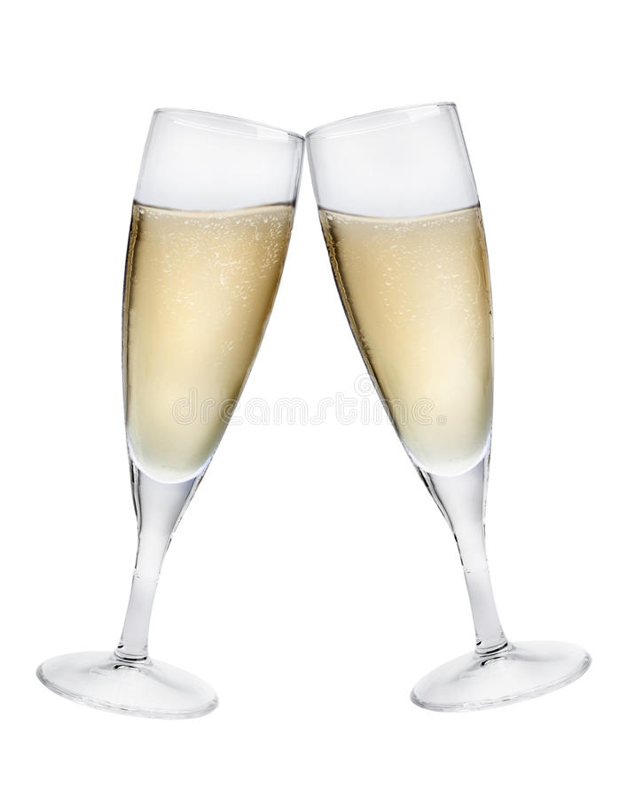 Champagne Toast. Champagne flutes making a toast isolated on white background royalty free stock photography