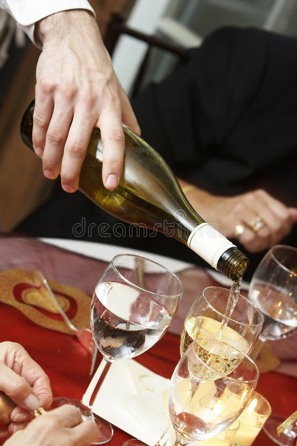 Champagne toast. Champagne being poured for a toast to the bride and groom royalty free stock photo