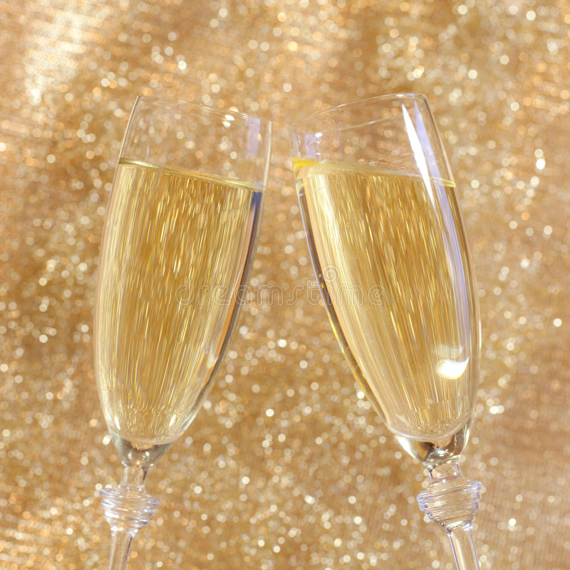 Champagne toast. With two glasses royalty free stock photo