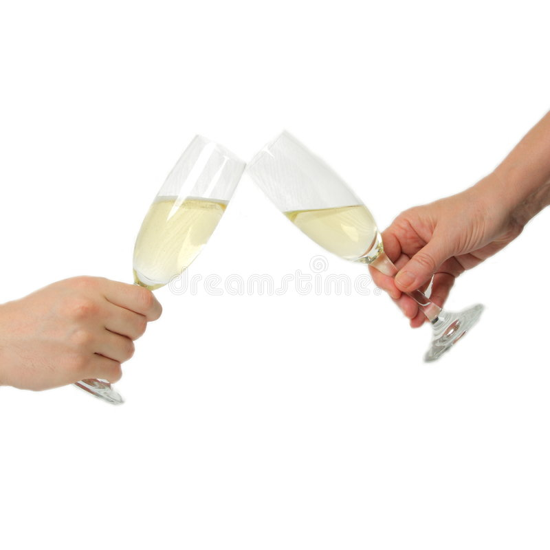 Champagne toast. Pair of champagne flutes making a toast royalty free stock image