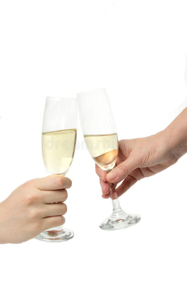 Champagne toast. Pair of champagne flutes making a toast stock images