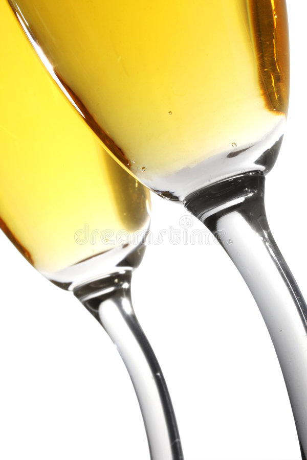 Champagne Toast. From low angle with curvy-stemmed glasses stock photo