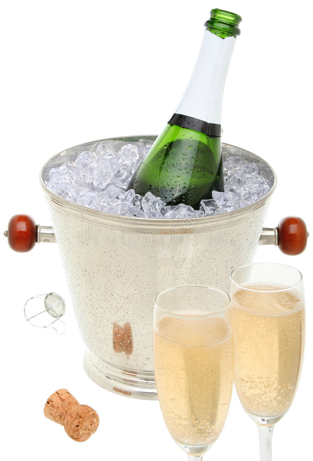 Champagne toast. Composition with a bottle of champagne in an ice bucket and two glasses filled with champagne stock images