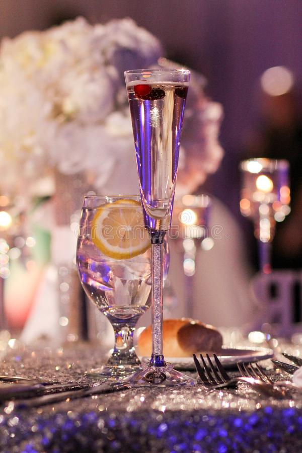 Champagne Toast with Cranberries for decoration. A couple add cranberries to their wedding toast as a sign of the season royalty free stock photography