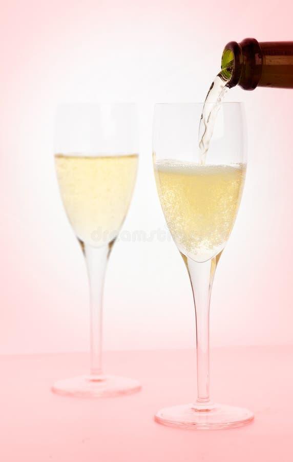 Champagne in un'opacità dentellare immagini stock