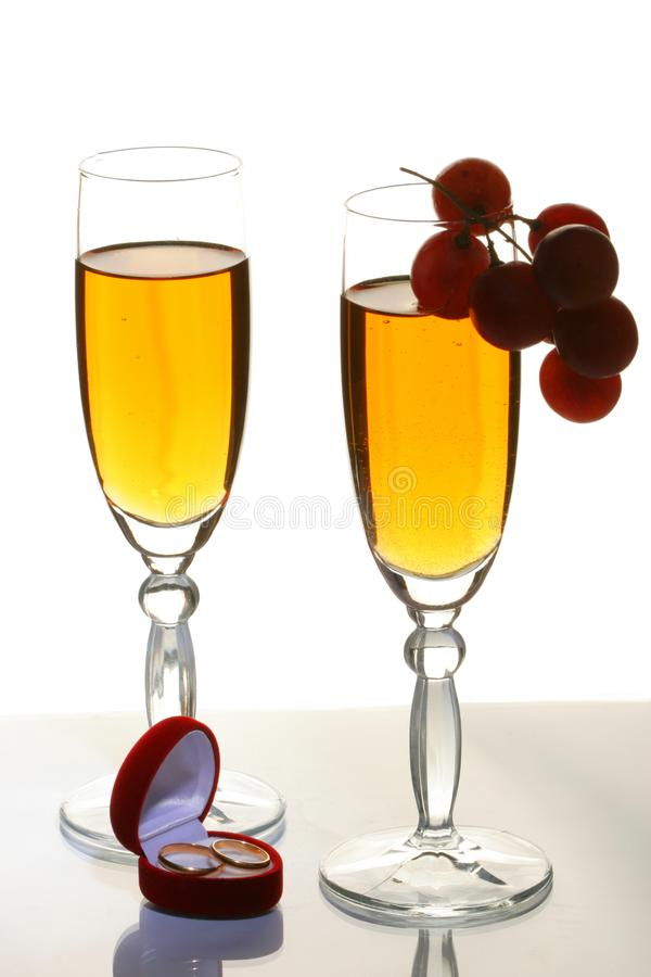 Champagne and wedding rings royalty free stock photo