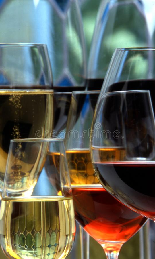 Champagne, white and red wins and drinks in glasses on stained g stock image