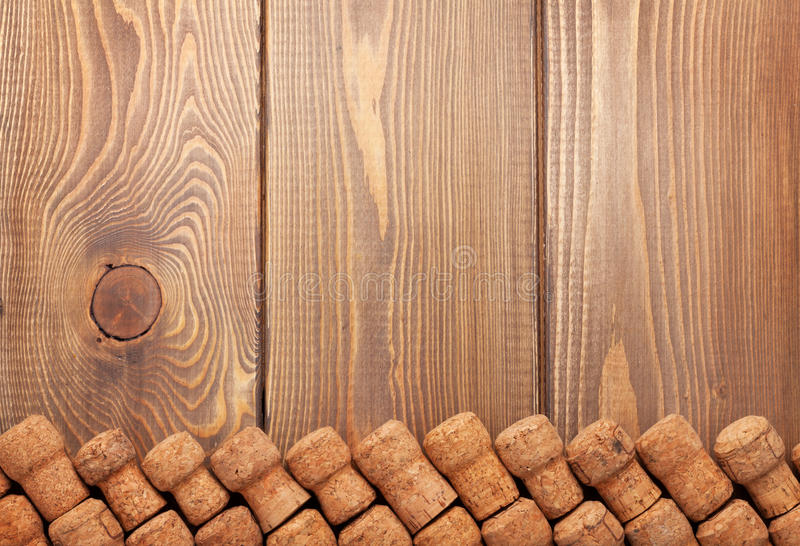Champagne wine corks over wooden table. Background with copy space royalty free stock image