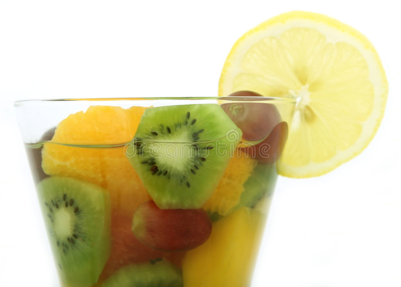 Champagne wine and fruit salad coctail in a glass
