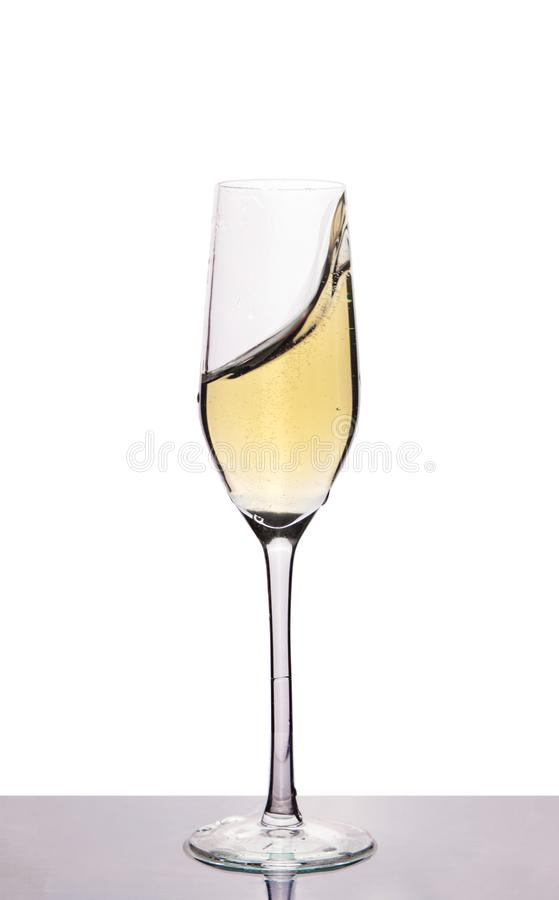 Champagne in wineglass on white stock photos