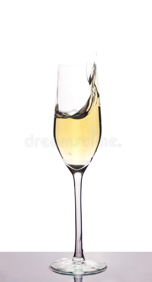Champagne in wineglass on white stock images