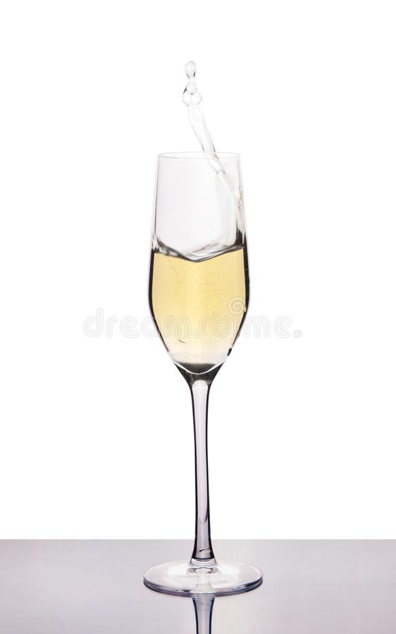 Champagne in wineglass on white royalty free stock images