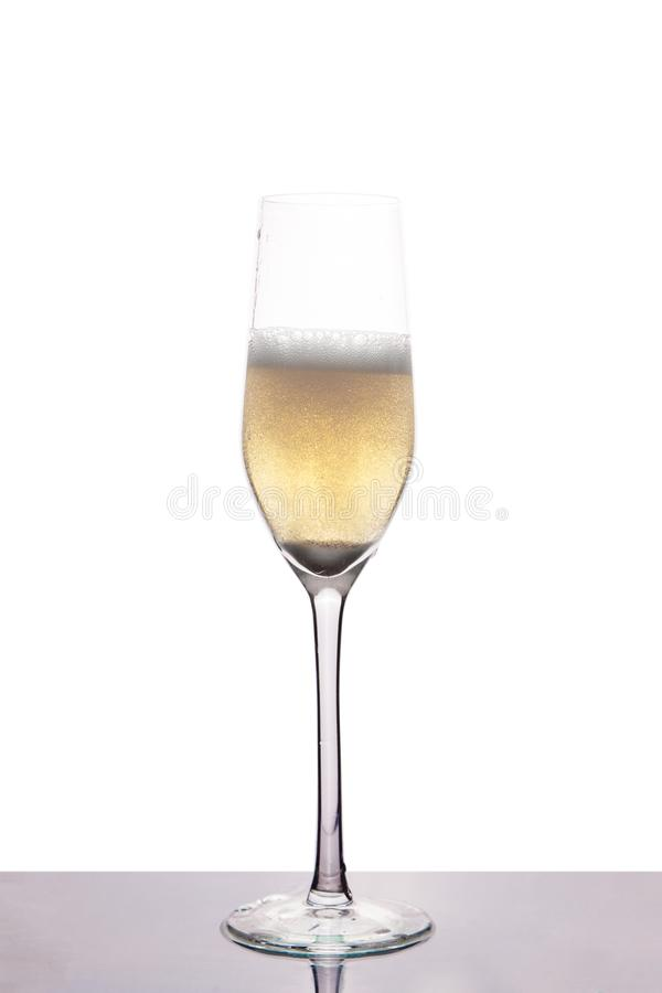 Champagne in wineglass on white royalty free stock photography