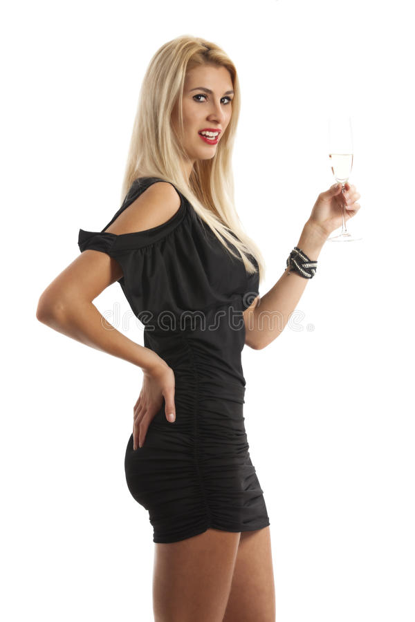 Champagne. Woman in a evening gown with champagne royalty free stock images