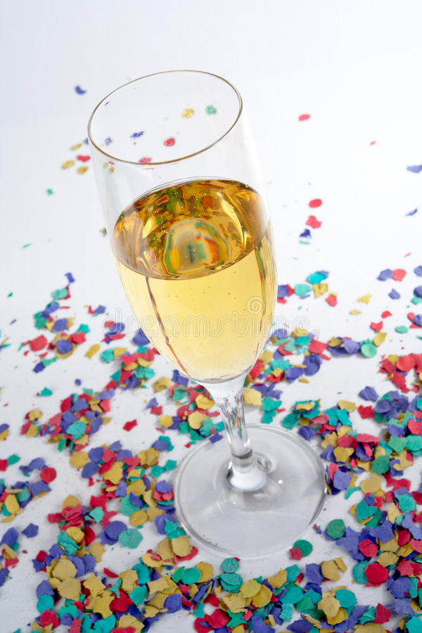 champagnekonfettiexponeringsglas royaltyfri foto