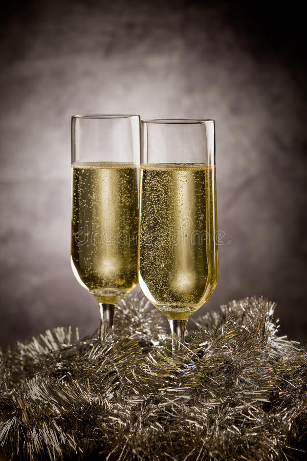 Champagner. New year champagner glasses in front of rural background royalty free stock photo