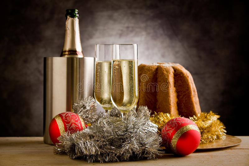 Champagner. Photo of two champagner glasses with christmas ornaments over the table royalty free stock photography