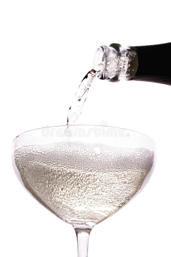 Champagner being filled into Glass. Champagner being filled into Coupe Glass stock photo