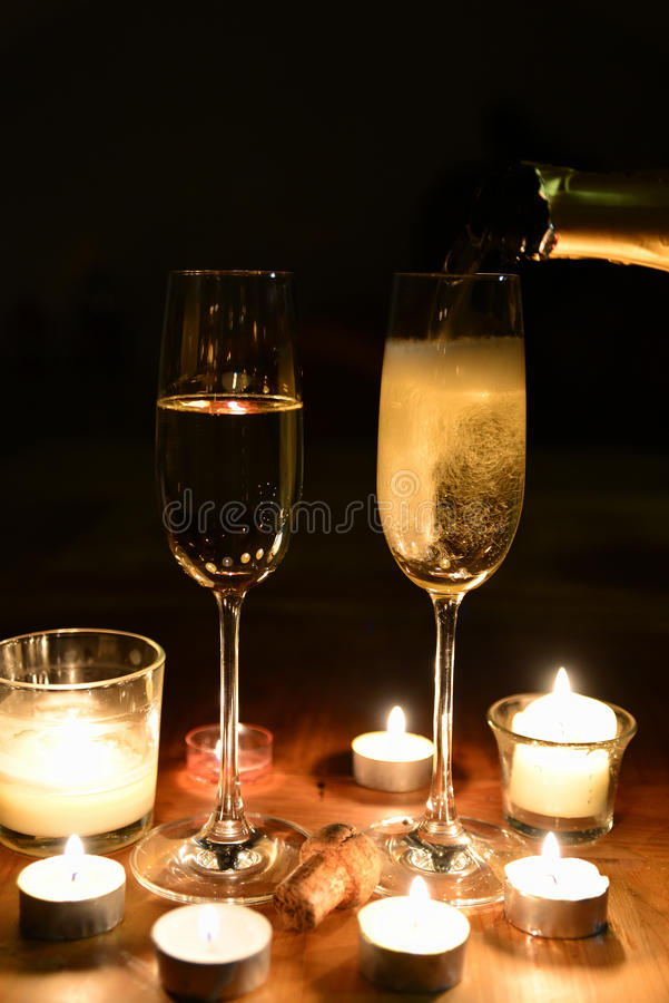 Champagner candlelight dinner. Champagne and candles romantic on a table royalty free stock images