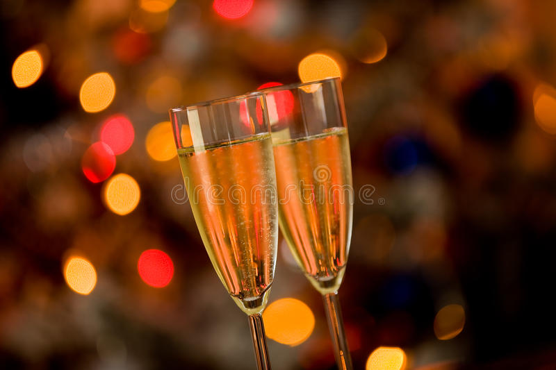 Champagner on Glass Table with Bokeh background. Photo of two champagner glasses on glass table with bokeh background royalty free stock photos
